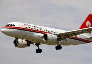 A Meridiana aircraft in flight.