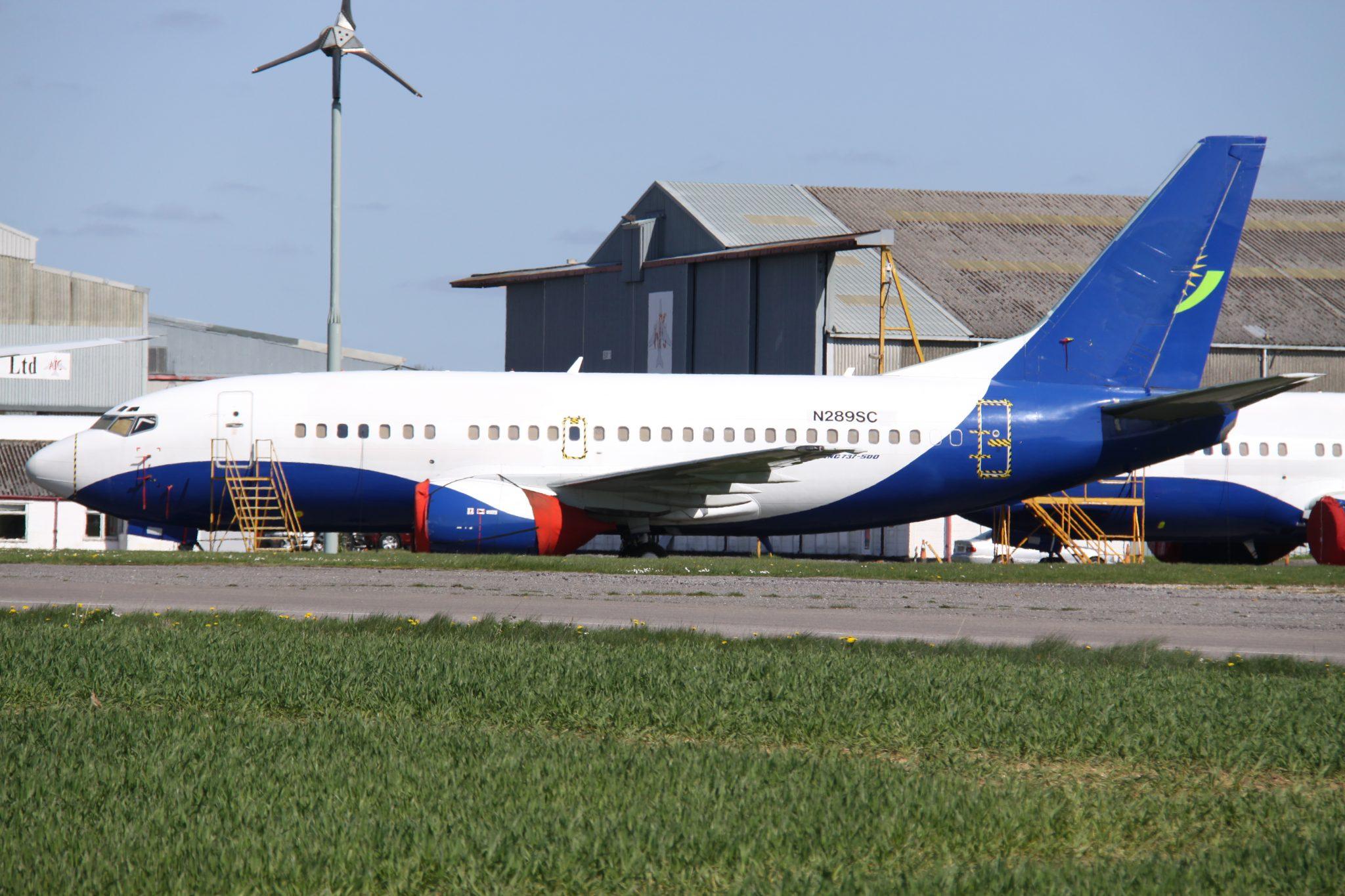 A RwandAir jet on the ground.